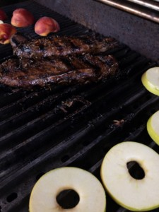Pork tenderloins, peaches and apples on the grill