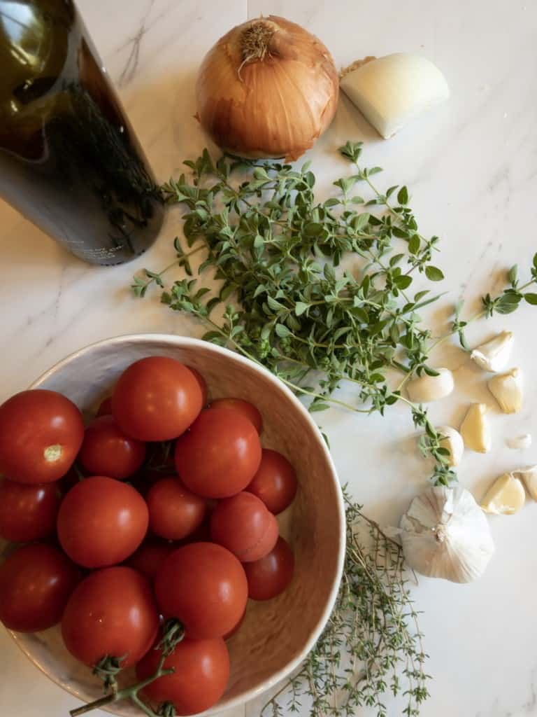Tomatoes, garlic herbs, onions and olive oil
