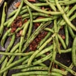 Grilled green beans and pancetta in a cast iron skillet
