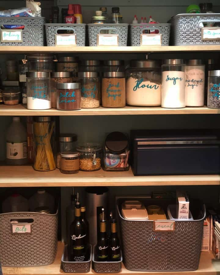 Organized pantry with labeled jars and bins