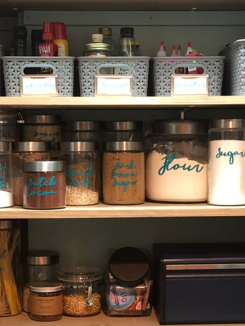 Pantry with labeled jars and bins